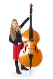 Young girl plays double bass in studio Stock Image