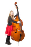 Young girl plays double bass in studio Stock Photos