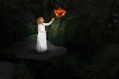 Young Girl Magic, Mystic, Witch, Witchcraft. A young girl plays with magic and is a mystic witch who practices witchcraft. Child love to pretend and play make Stock Photo