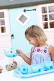 A young girl plays outdoors Stock Photography