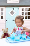 A young girl plays outdoors Royalty Free Stock Image