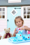 A young girl plays outdoors Royalty Free Stock Photos