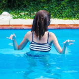 Young girl plays in a pool Royalty Free Stock Photos