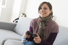 Young girl plays videogames Royalty Free Stock Photo