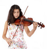 Young girl plays the violin Stock Photos