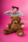 Young girl with a plush toy Royalty Free Stock Images