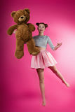 Young girl with a plush toy Royalty Free Stock Photos