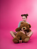 Young girl with a plush toy Royalty Free Stock Photo