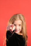 Young girl pointing. (focus on hand Stock Images