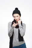 Young girl pointing at camera with look. Studio portrait of young attractive girl in casual winter clothing which pointing and looking at camera with look stock photography