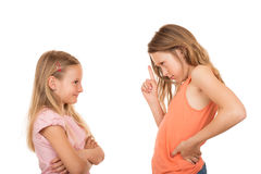 Young girl pointing finger at her sister Royalty Free Stock Image