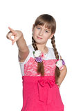 Young girl pointing forward Stock Photography