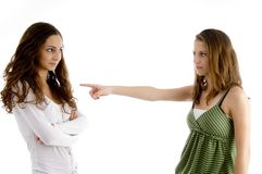 Young girl pointing to her friend Stock Photo