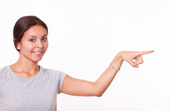 Young girl pointing to her left Stock Image