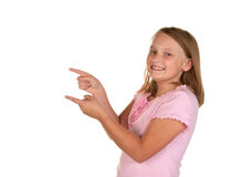 Young girl pointing on white Royalty Free Stock Photography