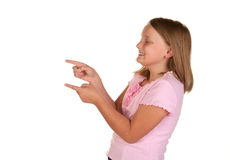 Young girl pointing on white Royalty Free Stock Photos