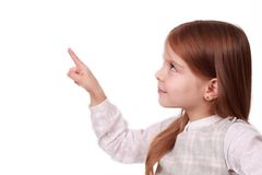 A young girl pointing at your text Royalty Free Stock Images