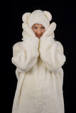 Young girl in the polar bear costume Stock Photography