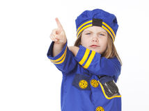 Young girl in police costume pointing. Isolated on white Royalty Free Stock Photo