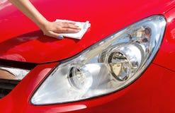 Young  girl polishing car Stock Photos