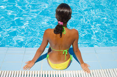 The young girl at pool. At hotel Royalty Free Stock Photo