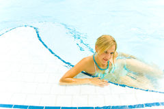 Young Girl In The Pool. Young couple having fun in the pool Stock Photography