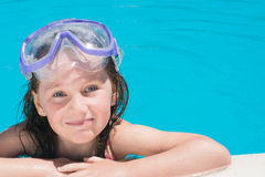 Young girl in the pool Stock Image
