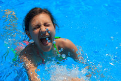 Young girl in pool. Young girl playing in the pool Stock Photo