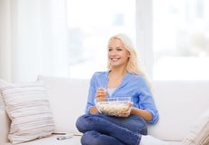 Young girl with popcorn ready to watch movie Royalty Free Stock Photography