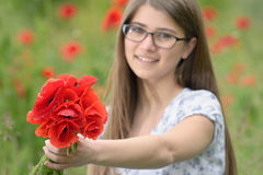 Young girl with poppy bouquet Royalty Free Stock Images