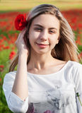 Young girl in the poppy field royalty free stock image