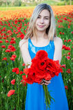 Young girl in the poppy field Royalty Free Stock Photography