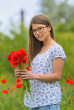 Young girl in the poppy field Stock Images