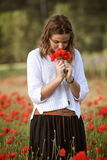 Young girl in poppy field Stock Image