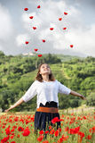 Young girl in poppy field Stock Images