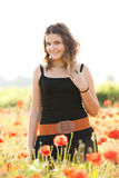 Young girl in poppy field Royalty Free Stock Image