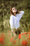 Young girl in poppy field Royalty Free Stock Photo