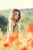 Young girl in poppy field Royalty Free Stock Photos