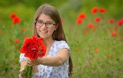Young girl in a poppy field Stock Image