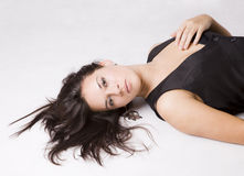 Young girl portrait. Close up of a pretty young girl lying on the floor Royalty Free Stock Photos
