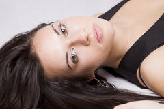 Young girl portrait. Close up of a pretty young girl lying on the floor Royalty Free Stock Image