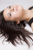 Young girl portrait. Close up of a pretty young girl lying on the floor Stock Photos