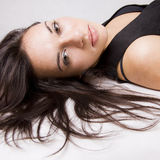 Young girl portrait. Close up of a pretty young girl lying on the floor Royalty Free Stock Photography