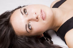 Young girl portrait. Close up of a pretty young girl lying on the floor Stock Photo