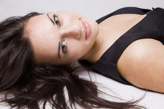 Young girl portrait. Close up of a pretty young girl lying on the floor Stock Images