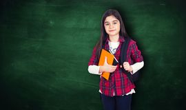 Young girl portrait with school chalkboard stock images