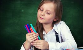 Young girl portrait with school chalkboard royalty free stock image
