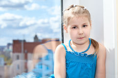 Young girl portrait with window, copyspace Stock Photography