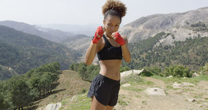 Young girl posing as boxer Stock Images