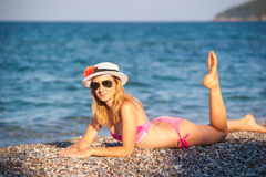 Young Girl Posing at Beach with Hat Stock Images